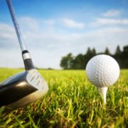 Playing golf. Golf club and ball.
