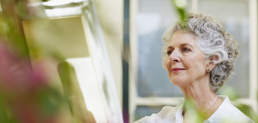 senior woman in independent living community painting