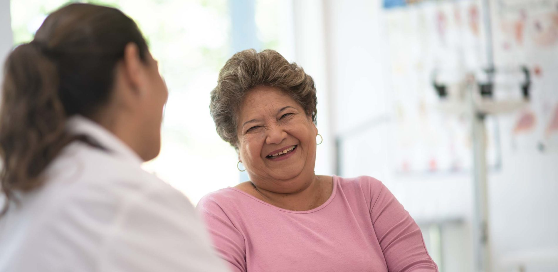 Woman speaking with physician