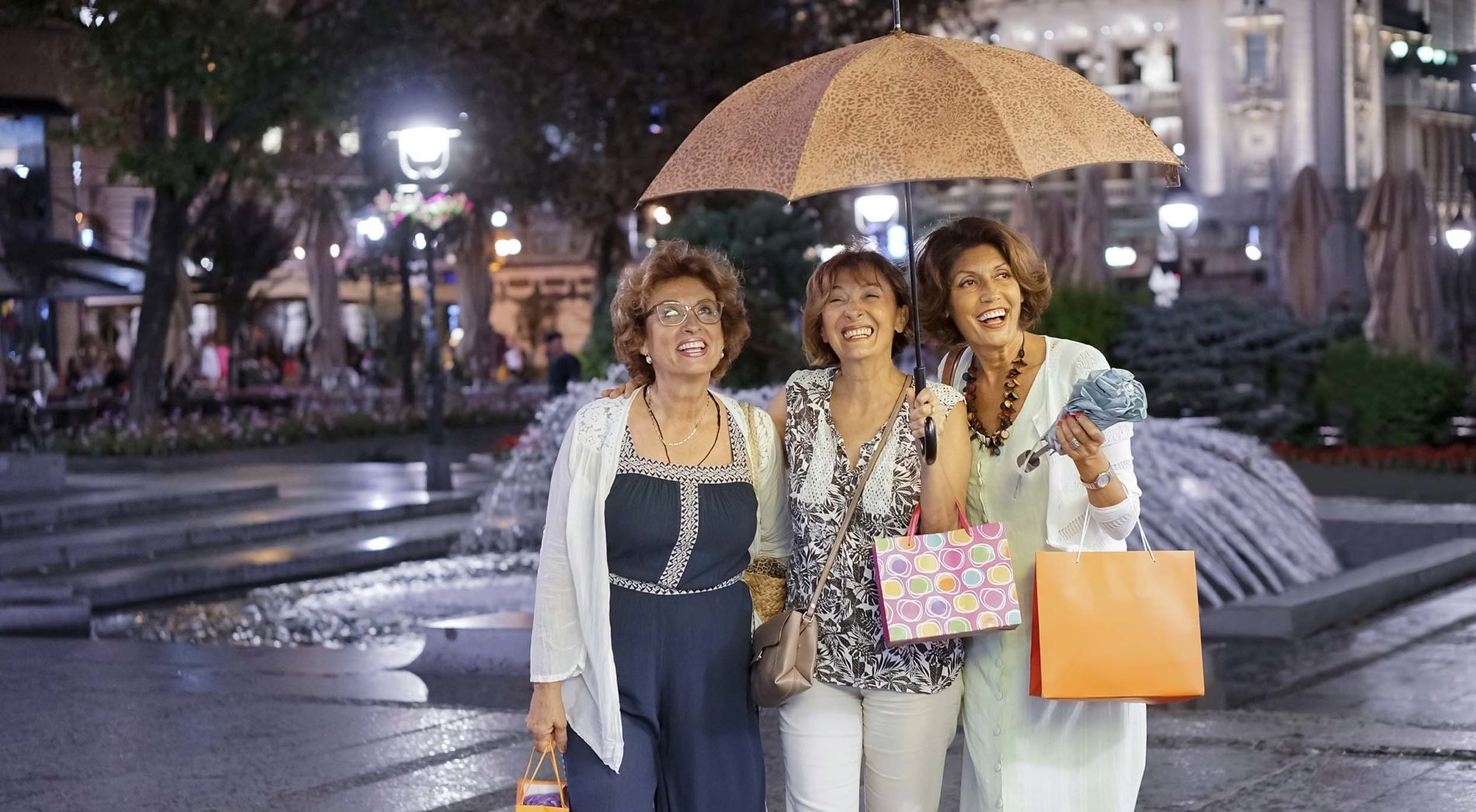 Women shopping in the rain