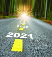 New year journey 2021 to 2024 on asphalt road surface with marking lines and sunlight